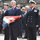 "Her Majesty's Lord-Lieutenant of Orkney Mr James William Spence, accompanied by members of the Royal Navy Northern Diving Group wait to lay up the battle ensign of HMS Royal Oak<br/><a href=""gallery/annual-service-2016/154/add/#comments""Add comment/a"