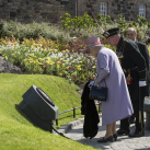 "The Queen unveils a plaque to commemorate her opening a new Memorial Garden<br/><a href=""gallery/royal-visit-3-july-14/110/add/#comments""Add comment/a"