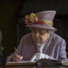 "The Queen signs the War Memorial Visitors Book<br/><a href=""gallery/royal-visit-3-july-14/100/add/#comments""Add comment/a"
