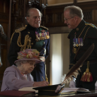 "The Queen signing whilst The Duke of Edinburgh talks to Maj Gen Mark Strudwick, Chairman of the Trustees of the Memorial<br/><a href=""gallery/royal-visit-3-july-14/101/add/#comments""Add comment/a"