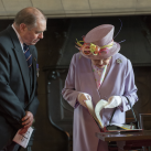 "Lt Col Roger Binks, The Keeper of The Rolls and Secretary to the Trustees of the Memorial presents The Queen with extracts from The Rolls recording the deaths of four of her relatives who died in World Wars One and Two.  One of the records is of her Uncle, the late Queen Mother's brother who died in World War One<br/><a href=""gallery/royal-visit-3-july-14/102/add/#comments""Add comment/a"
